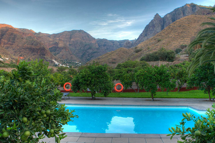swimming pool surrounded by mountains